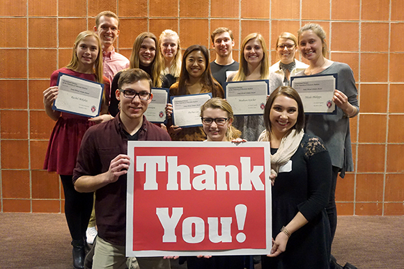 Students with thank you sign