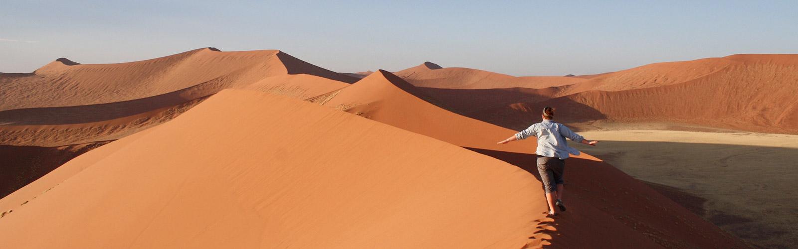 Student walking on Desert Dunes