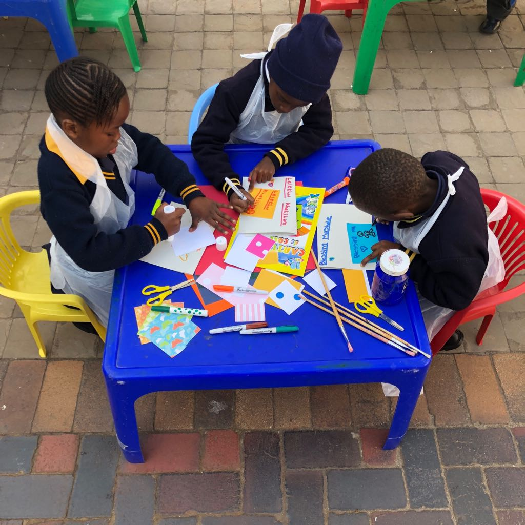 Children at Play Africa use various supplies to create art