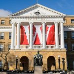 W banners hang from the columns of Bascom Hall at the University of Wisconsin-Madison during winter on Dec. 9, 2016. In the foreground is the Abraham Lincoln statue. (Photo by Jeff Miller/UW-Madison)