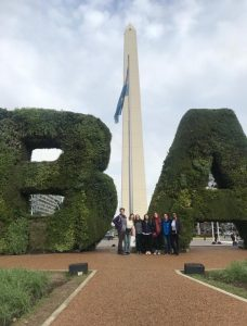 "Ananda and fellow students pose in front of obelisk and ""B"" and ""A"" made from greenery in Buenos Aires"