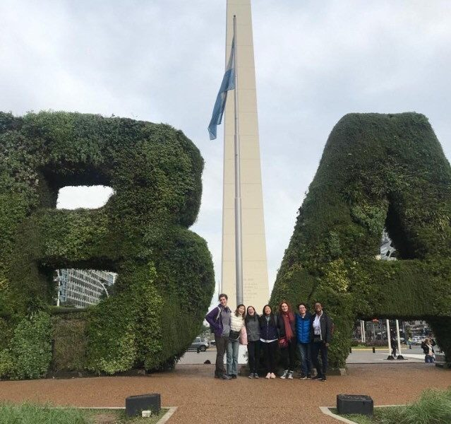 Ananda and fellow students pose in front of obelisk and
