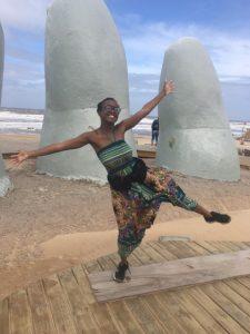 Ananda Deacon in front of La Mano de Punta del Este in Uruguay