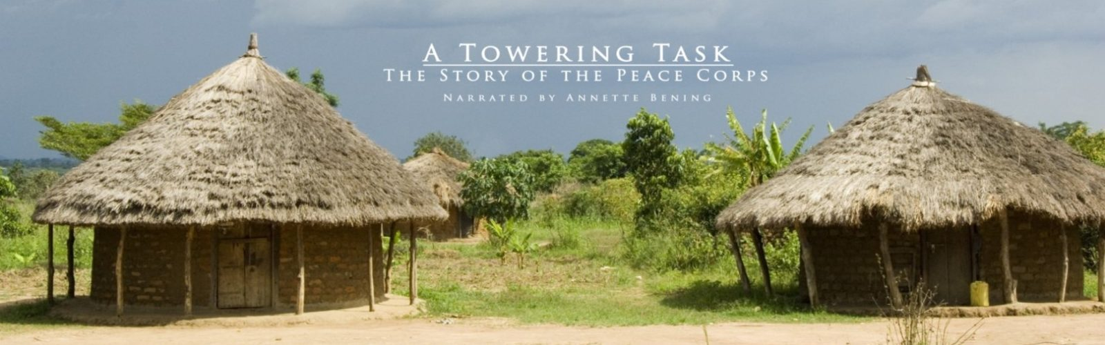 A Towering Task: The Story of the Peace Corps, narrated by Annette Bening. Two huts stand against a cloudy background amid lush greenery.