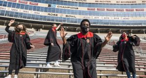 Lusayo Mwakatika celebrates commencement with fellow Senior Class Officers at Camp Randall. Mwakatika is the undergraduate commencement speaker.